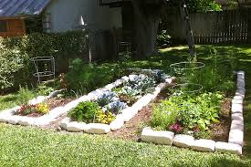 raised bed vegetable garden made of wood decorating with stones