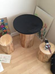 How To Make A Tree Stump End Table by Diy Tree Trunk And Toadstools Table Diy Inspired