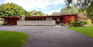 frank betz house plans for a midcentury exterior with a usonian