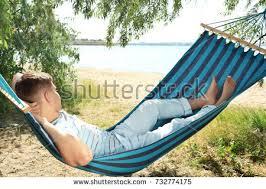 man hammock on tropical beach working stock photo 462974059