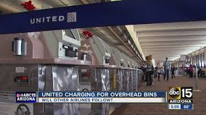 united airlines baggage charges united airlines now charging for carry on bags youtube