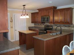 Bronze Faucet With Stainless Steel Sink Remodeled Kitchen Features Maple Cabinetry Quartz Countertops
