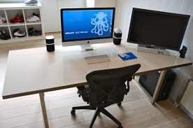a nice big beautiful desk that also functions as a white board