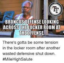 nfl broncos defense looking across the locker room at the offense