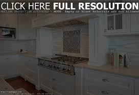 kitchen white cabinets dark countertops and slate backsplash