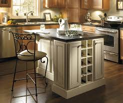 island in a kitchen light maple kitchen cabinets homecrest cabinetry