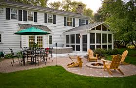 screened porch with spa deck patio and fire pit in barrington