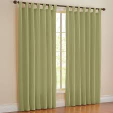 living room tab curtains with brown wooden floor and green