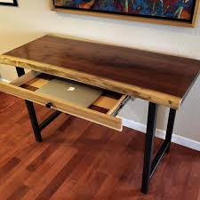 hand crafted walnut live edge desk with hand forged metal legs and