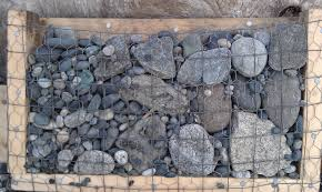 Stone For Garden Walls by Dry Stone Pebble Wall Stone Siding For Wooden Buildings