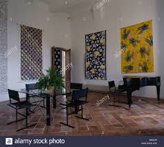 large abstract paintings on walls of modern diningroom with grand