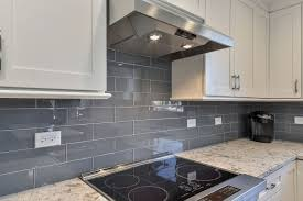 white kitchen cabinets with blue subway tile brian s kitchen remodel pictures home remodeling