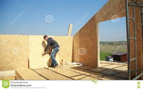 a man building a house foam polystyrene blocks made of plywood