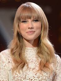 hair cuts for slightly wavy hair long hairstyles for blunt bangs taylor swift wavy hair style