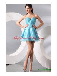 ruffled red quinceanera gown and light blue sweetheart beading