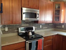 mission style cherry cabinets with ground quarts counter tops and mission style cherry cabinets with ground quarts counter tops and glass tile brick backsplash with building