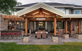 Outdoor Kitchen Storage Cabinets - stunning stone layers outdoor kitchen space features brown wooden