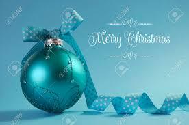 close up of beautiful aqua blue christmas tree ornament with