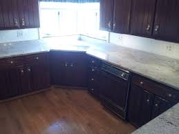 Cost Of Installing Kitchen Cabinets by Granite Countertop Refinishing Golden Oak Kitchen Cabinets Stick