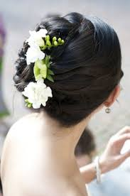 flower hair bun side swept side wedding hair with veil