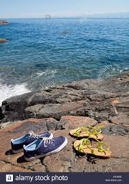 his and hers mens u0027 boat shoes and ladies u0027 sandals by the sea