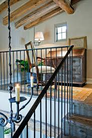wrought iron railing staircase rustic with baseboards corner
