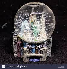 new york souvenir snowstorm in a snow globe stock photo royalty