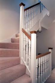a softwood staircase for a loft conversion painted white with
