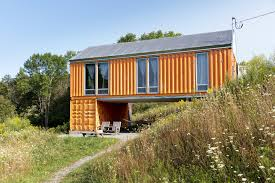 the shipping container as home a hammock and adirondack chairs