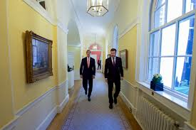 file secretary kerry walks down the main hall in no 10 downing