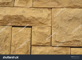 Wall Tiles by Grunge Brown Stone Wall Tiles Texture Stock Photo 667221526