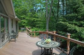 wrap around deck exterior design wrap around porch with metal chairs and metal