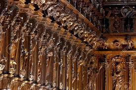 beautiful choir wood carving of a cathedral stock