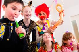 clown at children birthday entertaining the royalty