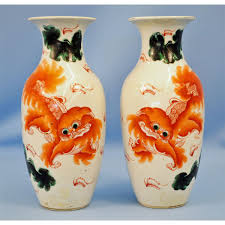 orange foo dogs porcelain vases w rust orange foo dogs