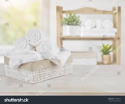 salon room spa towels on wood over abstract stock photo 473484916 shutterstock