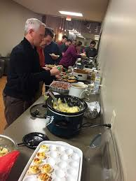 thanksgiving pot luck feast prelude services office photo