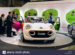 peugeot electric car paris france people looking psa peugeot citroen car company