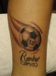 black ink football tattoo design for leg