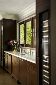 white kitchen cabinets with wood crown molding reaume construction design traditional kitchen design