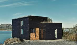 scandinavian design timber clad waterfront house in norway epitomizes modern
