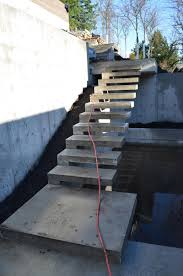 concrete cantilevered stair at the building site pinterest