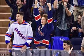 new york rangers fans ansel elgort falls over at the rangers game with joe jonas and gigi