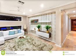 living room interior of a luxurious house with lights on editorial