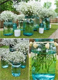 Ball Jar Centerpieces by Baby U0027s Breath In Blue Tinted Mason Jars Or Vases Simple