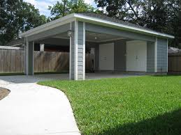 carport with storage door to kitchen and storage on sides with no