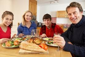 family lunch together in kitchen stock photo