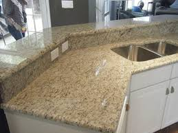 giallo ornamental granite countertops with white cabinets http