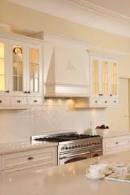french provincial kitchen with white subway tile and marble bench