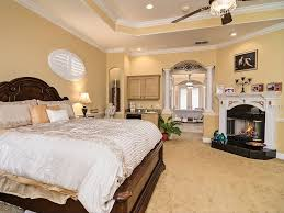 traditional master bedroom with stone fireplace u0026 crown molding in